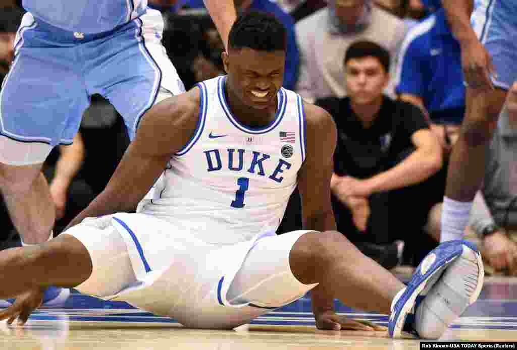 Duke Blue Devils forward Zion Williamson reacts after falling when his shoe split during the first half against the North Carolina Tar Heels at Cameron Indoor Stadium om Durham, North Carolina.