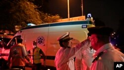 Police officers direct ambulances with bodies of Russian plane crash victims outside Zeinhom morgue in Cairo, Egypt, Oct. 31, 2015.