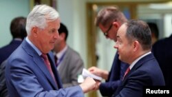 Polish Minister for European Affairs Konrad Szymanski, right, and the European Union's chief Brexit negotiator, Michel Barnier, attend an EU General Affairs Council meeting in Brussels, Belgium, Sept. 18, 2018.
