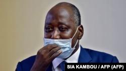 Amadou Gon Coulibaly, Ministre wa yambo ya Côte d'Ivoire, na bozongi na ye kowuta France, na libanda lya mpepo ya Abidjan, 2 juillet 2020.
