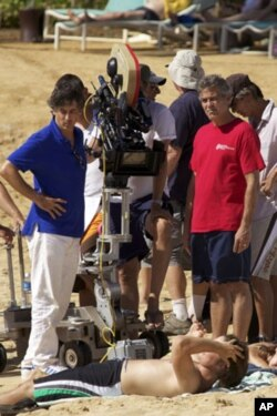 """The Descendants"" director Alexander Payne (left) with star George Clooney during filming in Hawaii."