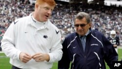 FILE - Penn State coach Joe Paterno, right, and assistant coach Mike McQueary walk off the field together before an NCAA college football game in State College, Pa., Oct. 10, 2009.