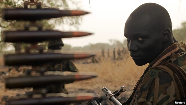 A South Sudan's army, or the SPLA, soldier sits in a truck on the frontline in Panakuach, Unity State,April 24, 2012.