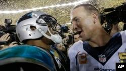 Carolina Panthers' Cam Newton, left, talks to Denver Broncos' Peyton Manning (18) after the NFL Super Bowl 50 football game, Feb. 7, 2016.