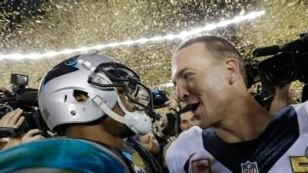 Carolina Panthers' Cam Newton, left, talks to Denver Broncos' Peyton Manning (18) after the NFL Super Bowl 50 football game Sunday, Feb. 7, 2016.