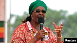Zimbabwe's First Lady Grace Mugabe addresses her maiden political rally in Chinhoyi after she was nominated to head the Zanu PF ruling party women's league two months ago, Oct. 2, 2014.