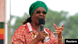 FILE: Zimbabwe's First Lady Grace Mugabe addresses her maiden political rally in Chinhoyi after she was nominated to head the Zanu PF ruling party women's league two months ago, Oct. 2, 2014.