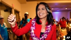 FILE - Rep. Tulsi Gabbard, D-Hawaii, greets supporters in Honolulu, Nov. 6, 2018. Gabbard has announced she's running for president in 2020.