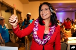 FILE - In this Nov. 6, 2018, file photo, Rep. Tulsi Gabbard, D-Hawaii, greets supporters in Honolulu. Gabbard has announced she's running for president in 2020.