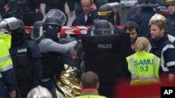 Hooded police officers detain a man in Saint-Denis, near Paris, Nov. 18, 2015.