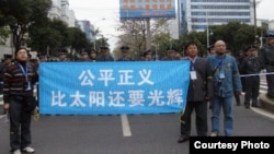 Wu Gan, right, takes part in a demonstration outside a court in Fuzhou, Fujian province. Wu is awaiting a decision in his trial.