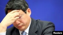 FILE - Liu Tienan, then deputy chairman of China's National Development and Reform Commission (NDRC), attends a news conference in Beijing, February 27, 2009.