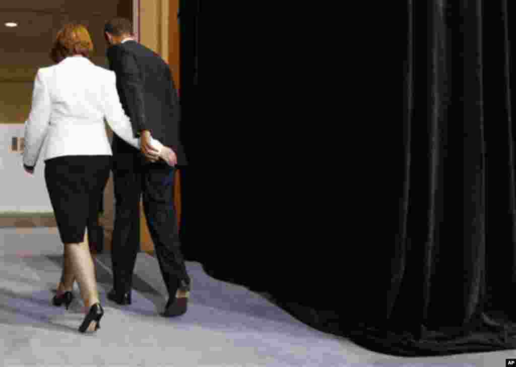 U.S. President Barack Obama and Australian Prime Minister Julia Gillard leave a joint news conference at Parliament House in Canberra, Australia, Wednesday, Nov. 16, 2011. (AP Photo/Charles Dharapak)