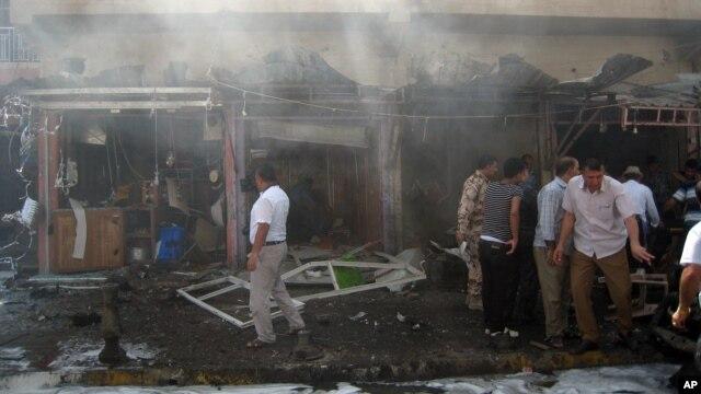 Hiện trường vụ nổ bom xe gần 1 cửa hàng bán súng ở Kirkuk, 290 km về phía bắc thủ đô Baghdad, Iraq, 19/9/2014.