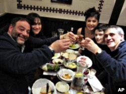 The Plaut family and friends give a hearty 'L'chaim' toast with some deli chocolate soda.