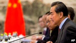 FILE - Chinese Foreign Minister Wang Yi speaks during a meeting at the Ministry of Foreign Affairs in Beijing, Jan. 27, 2016. He suggests that global growth, not politics, should be the focus of the G-20 summit in early September in the Chinese city of Hangzhou.