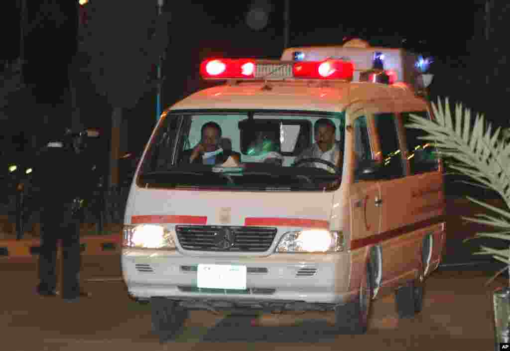 A Yemeni Ambulance carrying the bodies of two Belgian women at Sana'a airport, Yemen, Jan. 18, 2008. Gunmen believed to be al-Qaida militants opened fireon a tourist convoy in eastern Yemen. (AP Photo/ Mohammed al-Qadhi)