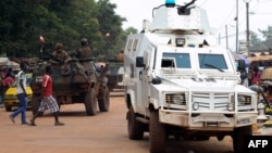 Police officers from the U.N. Multidimensional Integrated Stabilization Mission in the Central African Republic (MINUSCA) in an armored vehicle patrol a market in Bangui's Combattant district, Sept. 14, 2015.
