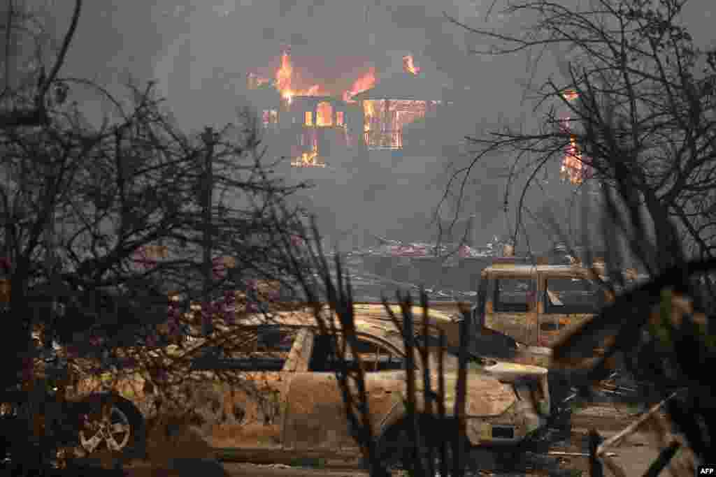 Fire consumes a home in Glen Ellen, California. Tens of thousands of acres and dozens of homes and businesses have burned in a widespread wildfire that is burning in Napa and Sonoma counties.