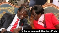 Rebecca Nyandeng (R), widow of the late rebel leader and first vice president of South Sudan, John Garang, in happier days, shown here with Vice President James Wani Igga. A decree issued on Aug. 19, 2014 by President Salva Kiir announced that Nyandeng has been fired.