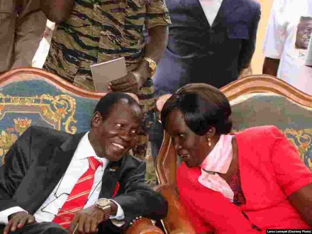 South Sudan's new vice president, James Wani Igga, speaks with Rebecca Nyandeng, widow of the late rebel leader and first vice president of South Sudan, John Garang.
