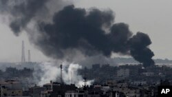 Smoke from Israeli strikes rises over Gaza City, in the northern Gaza Strip, July 27, 2014.