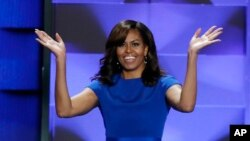 FILE - First lady Michelle Obama walks on stage during the first day of the Democratic National Convention in Philadelphia, July 25, 2016.