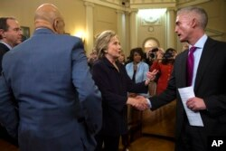 Democratic presidential candidate former Secretary of State Hillary Rodham Clinton shakes hands with House Select Committee on Benghazi chairman Rep. Trey Gowdy, R-S.C., at the conclusion of a hearing, on Capitol Hill on Thursday, Oct. 22, 2015
