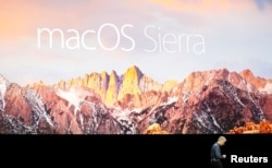 Craig Federighi, Senior Vice President of Software Engineering for Apple Inc, discusses the macOS Sierra at the company's World Wide Developers Conference in San Francisco, California, U.S. on June 13, 2016.
