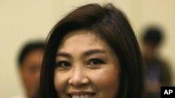 Yingluck Shinawatra, première Thailandaise à former un gouvernement