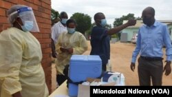 Chitungwiza Municipality Director of Health and Environmental Services Dr Kasu getting vaccinated at Seke South Clinic