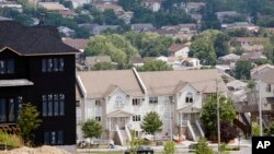 FILE - In this July 1, 2014, file photo, a new housing unit, left, is under construction in Kiryas Joel, N.Y. Agents with the FBI and other law enforcement agencies have seized documents from the Hasidic village on May 12, 2016, as part of an ongoing investigation.