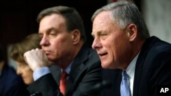Senate Intelligence Committee chairman Sen. Richard Burr, R-NC, right, speaks next to Vice Chairman Sen. Mark Warner, D-VA., during a Senate Intelligence Committee hearing on Russian election activity and technology, Nov. 1, 2017, on Capitol Hill in Washington.