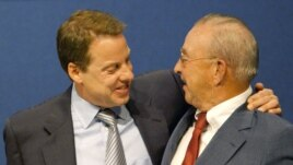 FILE - Ford Motor Company Chairman William Clay Ford Jr. (L) hugs his father, William Clay Ford Sr. (R), on June 16, 2003, in Dearborn, Michigan. The year 2003 marked the 100th anniversary of the company's founding.
