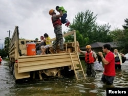 Texas National Guard soldiers aid residents in heavily flooded areas from the storms of Hurricane Harvey in Houston, Texas, Aug. 27, 2017