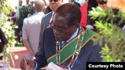 FILE: President Robert Mugabe swearing in ministers soon after the 2013 general election.