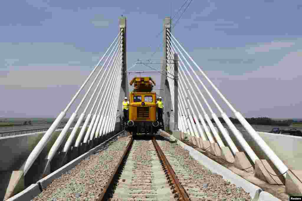 A train travels on the newly constructed bridge over the Danube River, that links Calafat in Romania to Vidin in Bulgaria, as finishing touches are made before its inauguration, 320 km (199 miles) southwest of Bucharest, Romania.