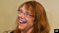 Mavis Wanczyk, of Chicopee, Mass., smiles during a news conference where she claimed the $758.7 million Powerball prize at Massachusetts State Lottery headquarters, Aug. 24, 2017, in Braintree, Mass. Officials said it was the largest single-ticket Powerball prize in U.S. history.