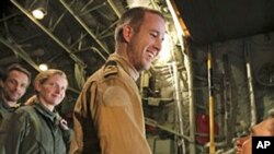 Three Dutch marines who were captured after a botched evacuation mission in Libya last month arrive at Athens' airport, March 11, 2011
