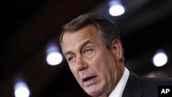 House Speaker John Boehner of Ohio speaks to reporters on Capitol Hill in Washington, June 16, 2011