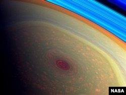 The Cassini spacecraft has captured the first detailed images of a giant hurricane on Saturn.