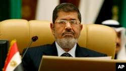 Egyptian President Mohamed Morsi attends the third session of the Arab Economic Summit in Riyadh, Saudi Arabia, Jan. 21, 2013.