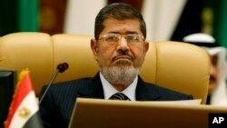 FILE - Egyptian President Mohamed Morsi, Jan. 21, 2013.