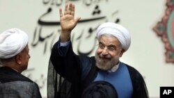 Iran's new president, Hassan Rouhani, waves after his swearing-in at the parliament in Tehran, August. 4, 2013.