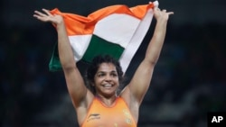 India's Sakshi Malik reacts after winning bronze against Kyrgyzstan's Aisuluu Tynybekova in the Women's Wrestling Freestyle 58-kg Competition at the 2016 Summer Olympics in Rio de Janeiro, Brazil, Aug. 17, 2016.