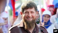 Chechnya's regional leader Ramzan Kadyrov smiles while visiting the Chechen State University in Chechnya's provincial capital Grozny, Russia, Aug. 11, 2016.