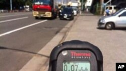 Safecast contributor Pieter Franken takes a mobile probe radiation measurement in Japan.