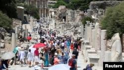 FILE - Tourists visit the ancient city of Ephesus near Izmir in the western Aegean region, Turkey, Aug. 5, 2018.