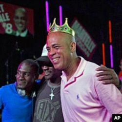 Haiti's presidential candidate Michel Martelly poses for a photo with supporters at a campaign rally in Gonaives, Mar 11 2011