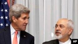 John Kerry y Mohammad Javad Zarif durante las conversaciones nucleares en Suiza.